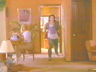 Josh chases after Max through the house