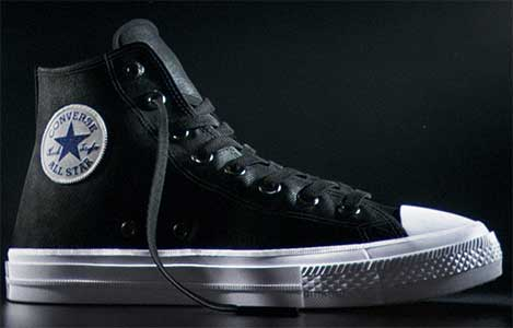 36d694eb5cf6 black chuck taylor all star II high top. Inside patch view of a ...