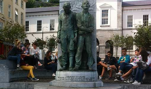 Young people wearing chucks at the Lusitania memorial stature in Cobh, Ireland