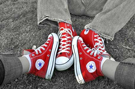 WEaring red high top chucks