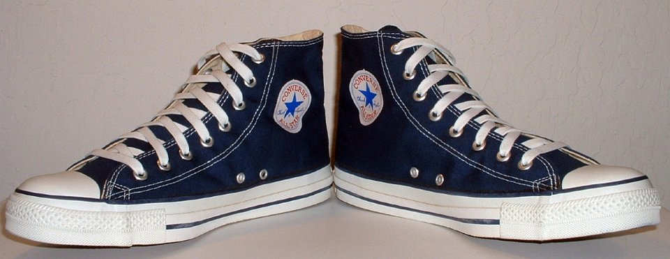 10 Core Navy Blue High Top Chucks Angled front view of navy blue high tops. ded60af9e