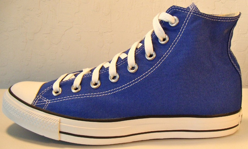 f3898ac073a1 4 Dazzling Blue High Top Chucks Outside view of a left dazzling blue high  top chuck.