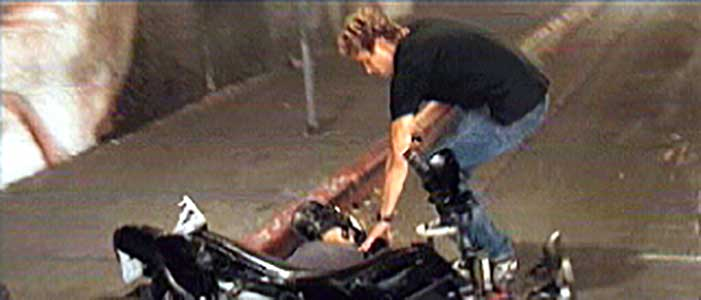 Brian checks to see if one of the motorcyle assassins from the Asian gang is dead