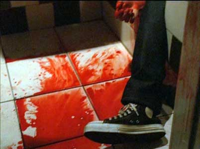 The camera focuses on the shoe of one of Gacy's victims
