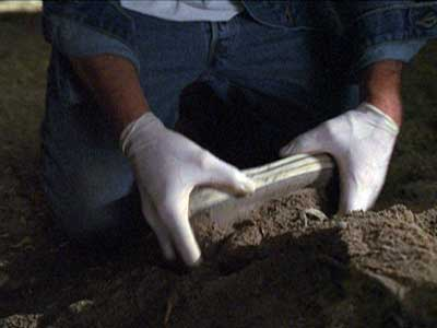 The investigator stumbles onto a gruesome discovery in Gacy's basement.