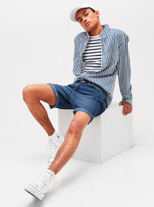 ee2bd019ce 19 Guys Wearing Optical White Chucks Wearing optical white high tops with a  horizontal striped long sleeved shirt