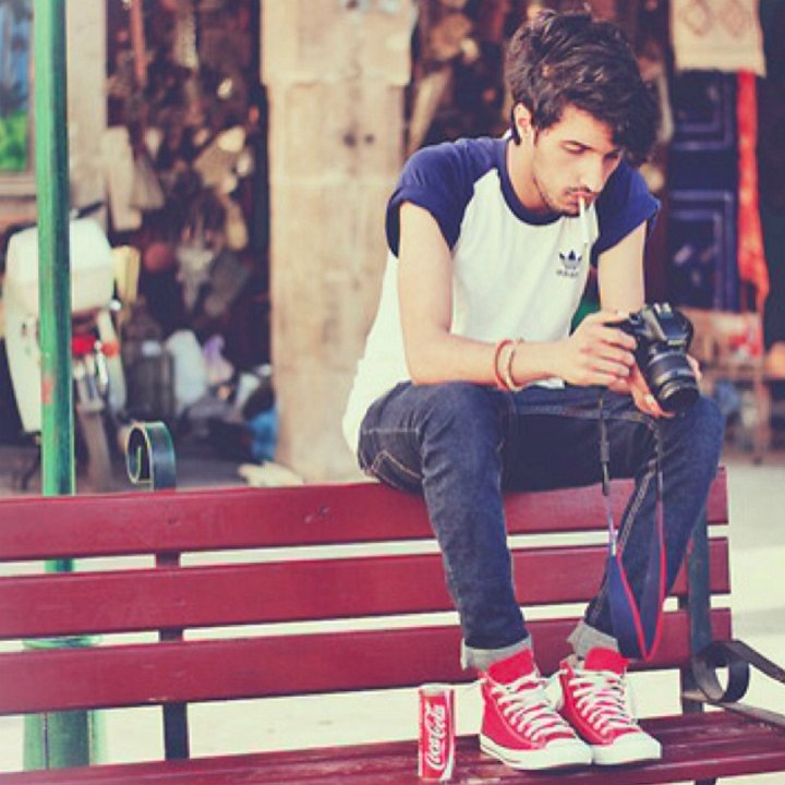 17 Guys Wearing Red Chucks Guy wearing red high top chucks with blue jeans  and a blue and white tee shirt. 422d48cd3