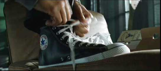 Spooner laces up his new pair of chucks