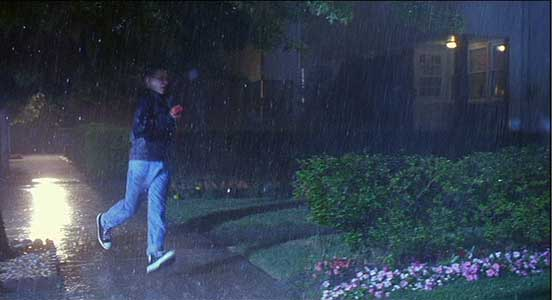 Lenny runs over to Hedy's house in the pouring rain.