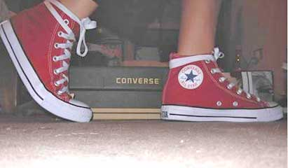 red high top chucks with shoelaces that are too long