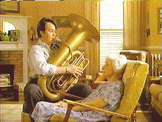 Harry plays the tuba for his mother