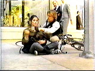 Jack helps Terri after a truck knocks her off her bicycle