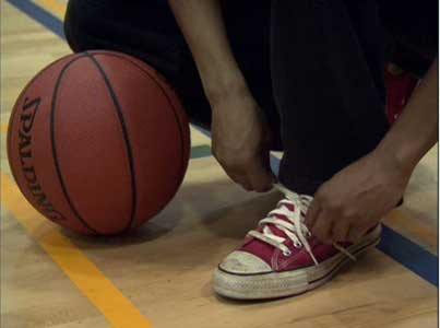 Reggie laces up the red sneakers for the first time