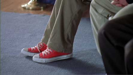The first shots we see of Mr. D at the assembly are closeups of his red high top chucks