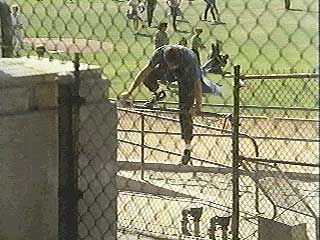 Michael scales the school fence