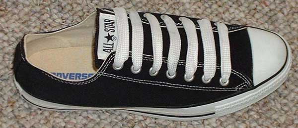 black low cut with white fat shoelaces