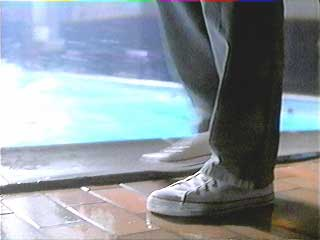 Mr. Baker, Joe's swim coach, wears white chuck high tops
