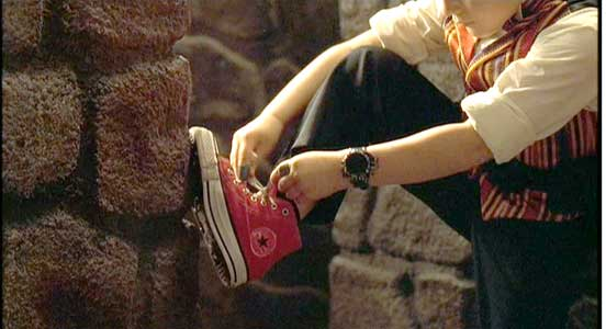 Juni takes a moment to lace up his red high top chucks