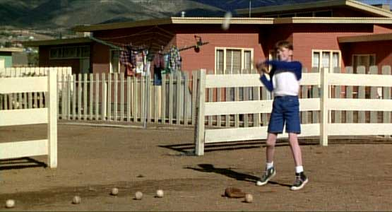 Joseph Mazzello learns how to hit a ball
