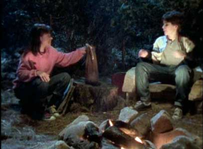 Betty Ann and David by the campfire