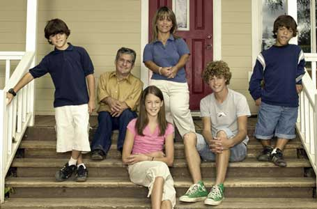 The Roloff family sitting on their front porch